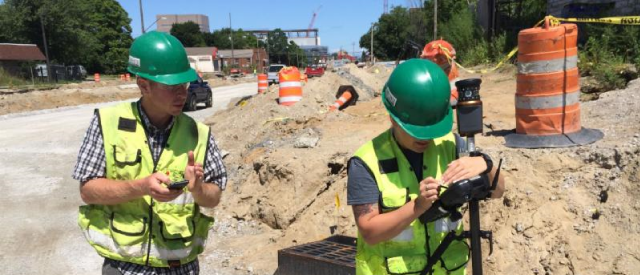 Professional Surveyor Dustin Addair, PS lays out and stakes the Opportunity Corridor in Cleveland, Ohio.