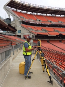 Survey Crew Chief Rocky Porterfield performs construction surveying for Beyonce OTR II concert stage in Cleveland.